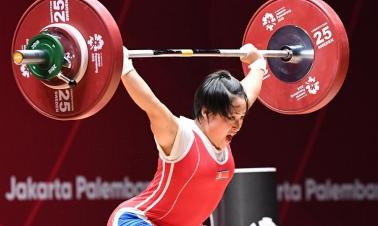 In pics: Ri Song Gum of DPRK during women's weightlifting 48kg final at 18th Asian Games